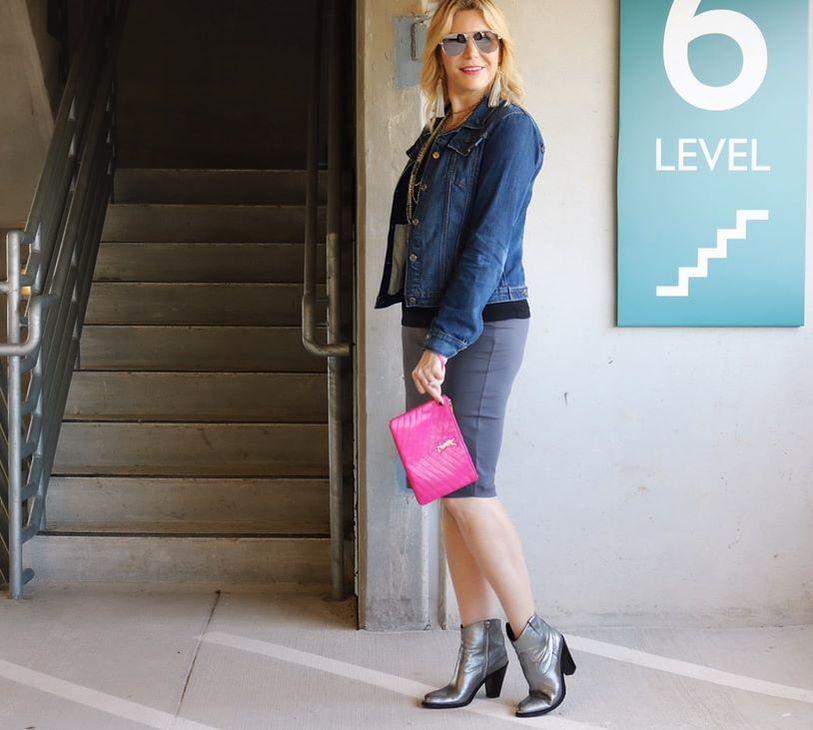 universal-standard-skirt-ysl-booties-jean-jacket-ysl-clutch